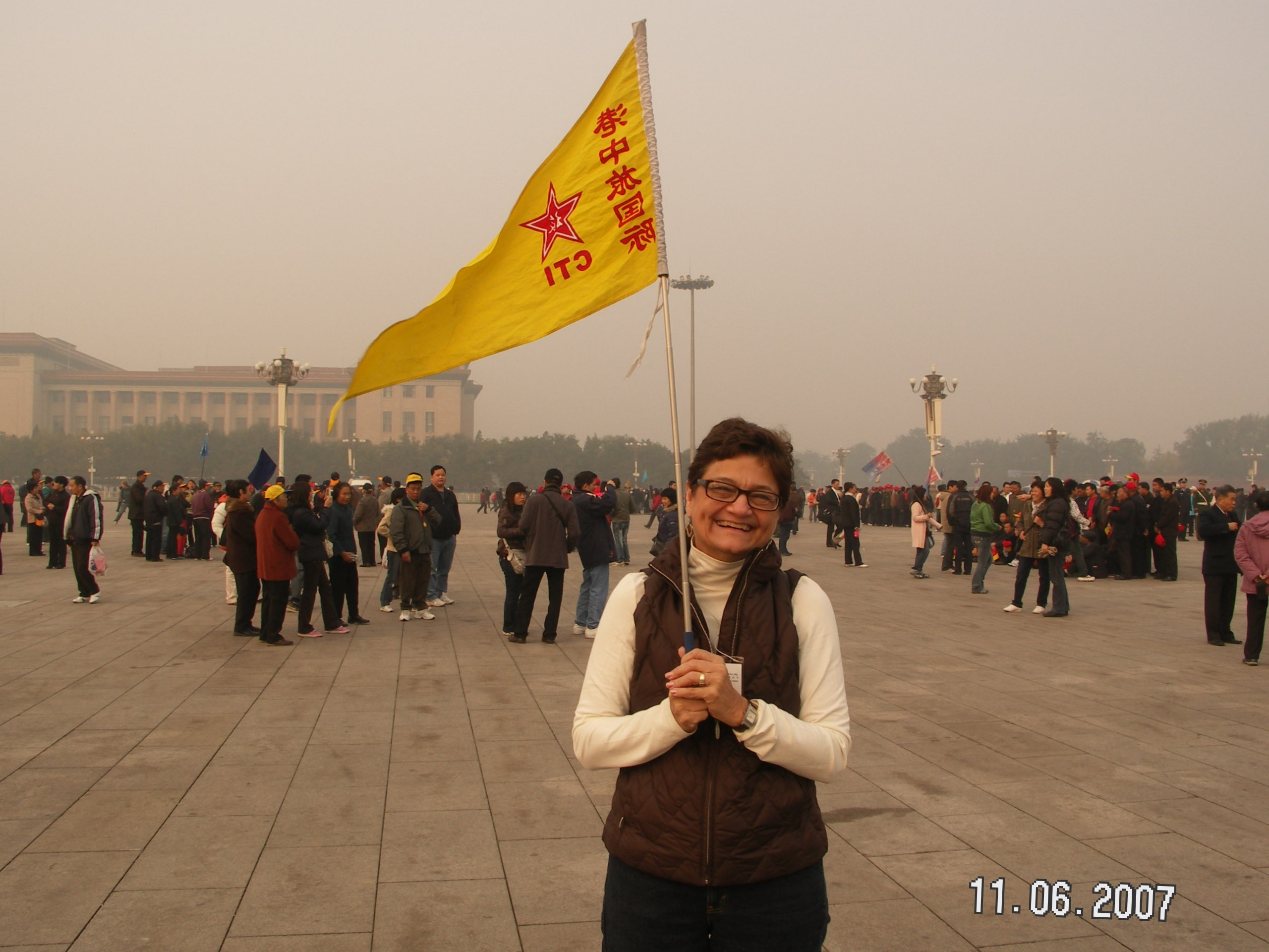 Yes, that is me in Tiananmen Square...with the guide's flag...more than scary given my navigational skills! I got us lost in Bejing and lost our souvenirs from the Mao museum all on day one!