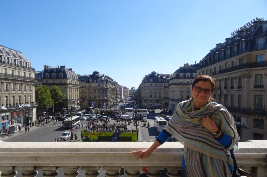 Standing on the balcony outside the Opera House with the Parisienne cityscape as my backdrop. Do I look happy? Oh yeah!