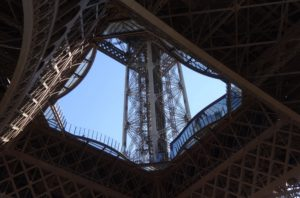 Looking up through the center of the Eiffel Tower. What an amazing view! I felt dwarfed standing under the tower, using it's center window to frame the sky.