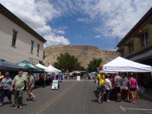 Palisades---lovely town just off the Interstate slightly east of Grand Junction. We stopped primarily to pick up some peaches. This area of Colorado is a garden stuffed with fruits and vegetables one can only dream of. We found the Sunday market in full swing...so in the shadow of the Book Cliffs on one side and the looming spectacle of the Grand Mesa on the other we wamdered the tree lined streets taking in all the renovated Victorian houses and enjoying the fresh produce and crafty shopping in this little town.